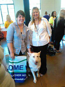 HOME WORKS!'s Cailtin Zera with King, a therapy dog with Support Dogs. King visits hospice patients and is also one of the organization's reading dogs (kids who struggle to read get to practice reading out loud to him, in a comfortable, safe, nonjudgmental environment).